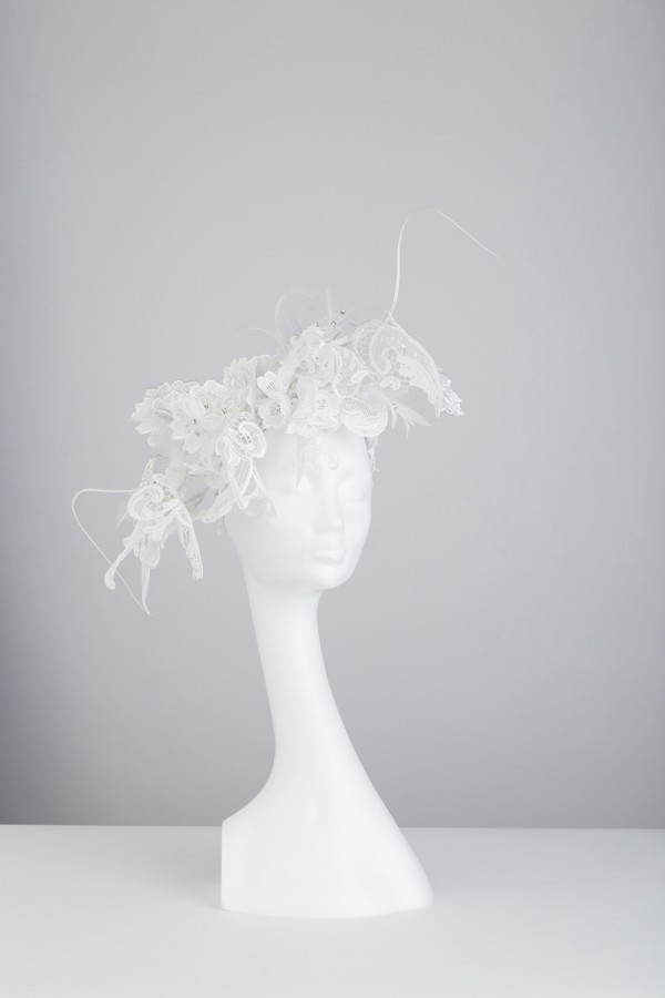 Single headpiece with white wired cotton embellished on feather spine.