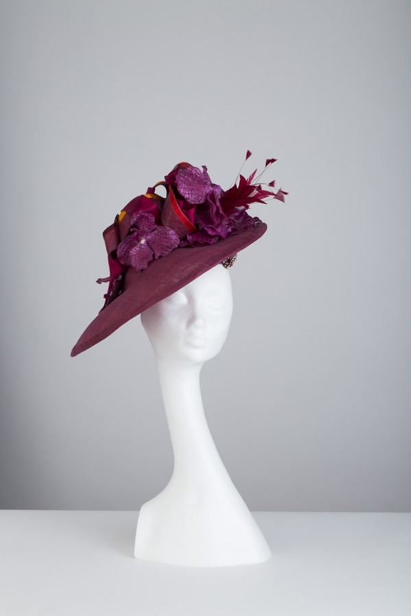 Single rimmed, lilac coloured, sinemay with floral and feather embelishments